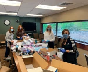 COM Students packing supplies for Marshallese testing