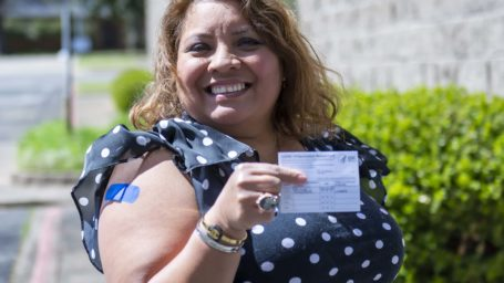 Irma Chavez showing vaccine card